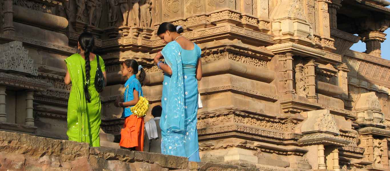 India and Nepal wildlife safari slide of sari dress and sandstone sculptures at Khajuraho temple