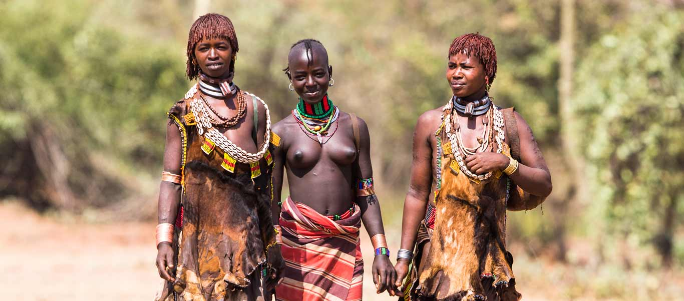 Ethiopia culture tours slide showing Hamer women in South Omo Valley