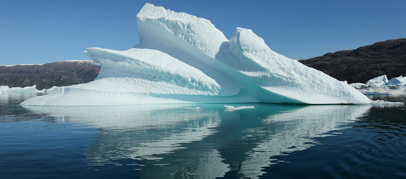 Greenland tour slide featuring an iceberg
