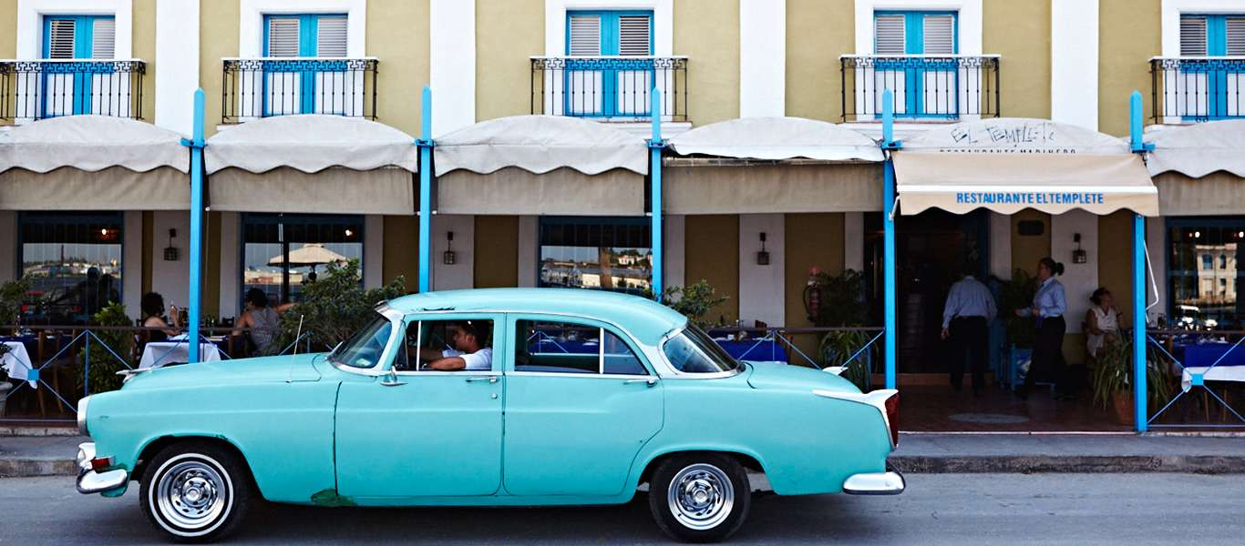 Cuba tours slide showing classic American car in Havana