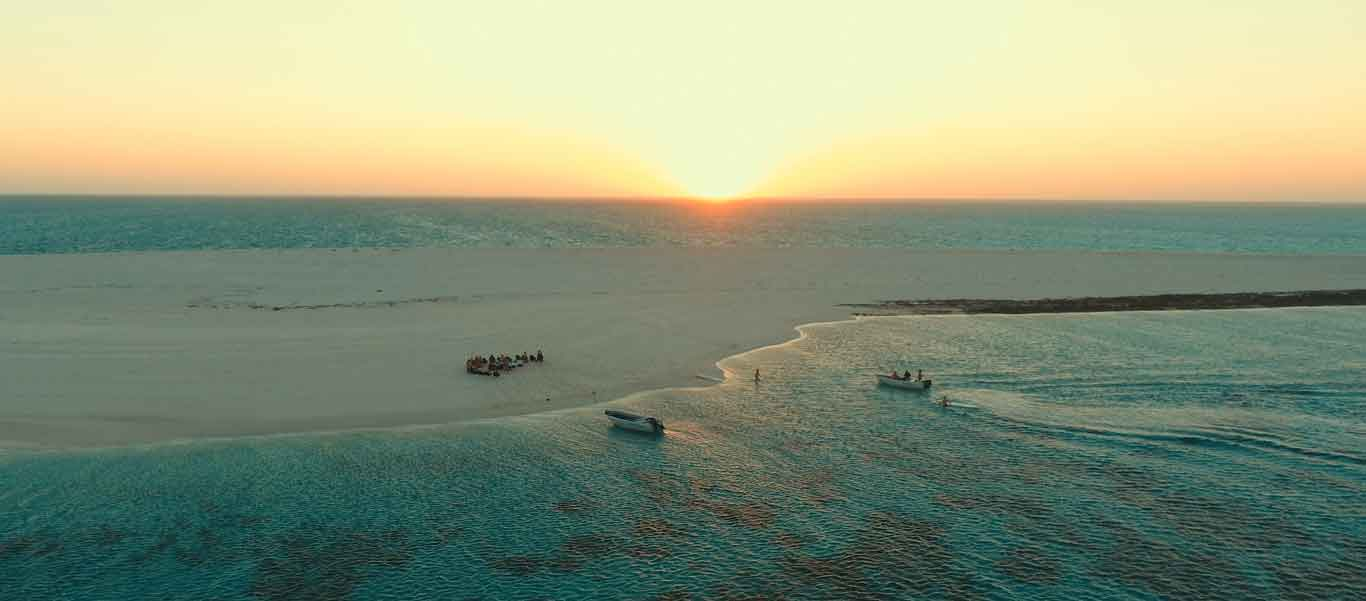 Rowley Shoals diving photo of sundowners on beach