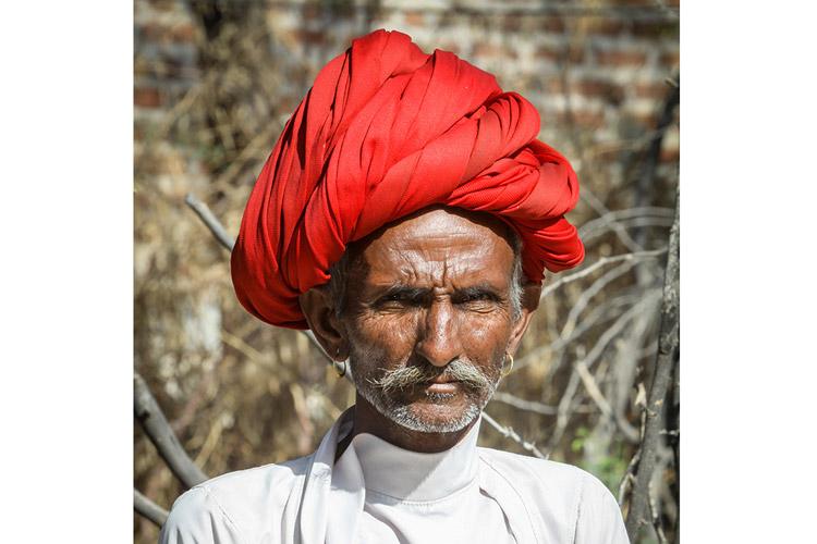 India wildlife safari slide featuring local man