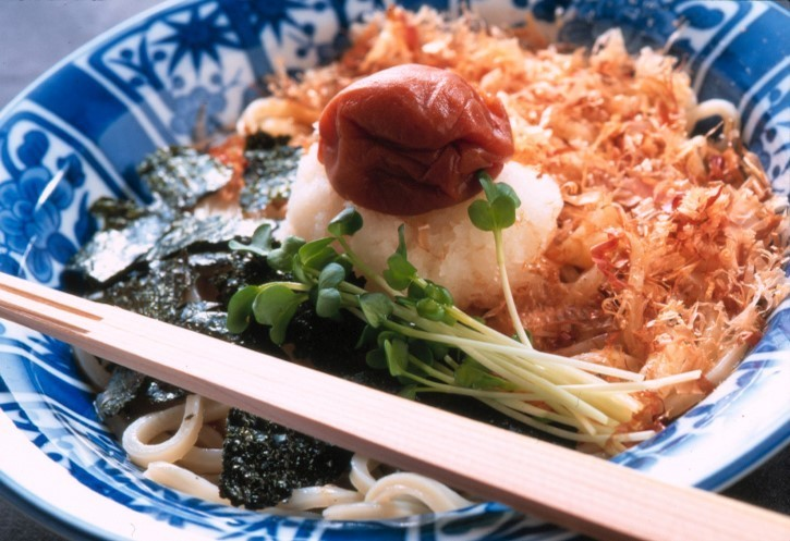 Japan tours slide showing cuisine with chopsticks