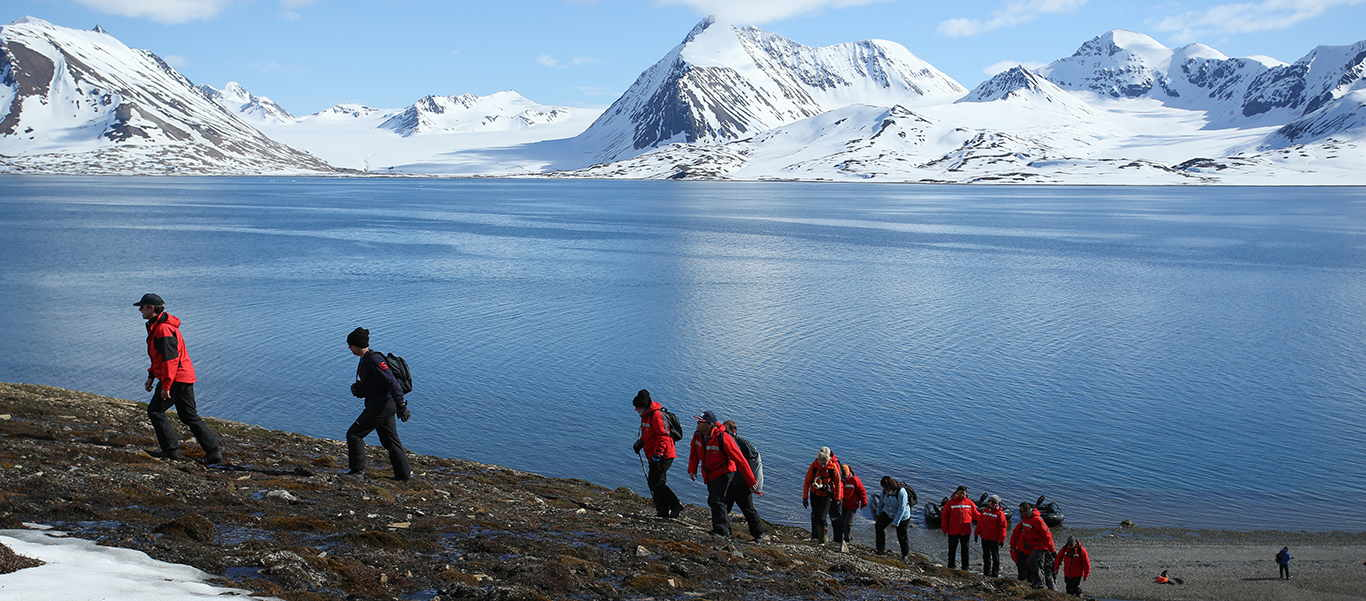Baffin Island and Greenland tour slide showing hikers and mountains