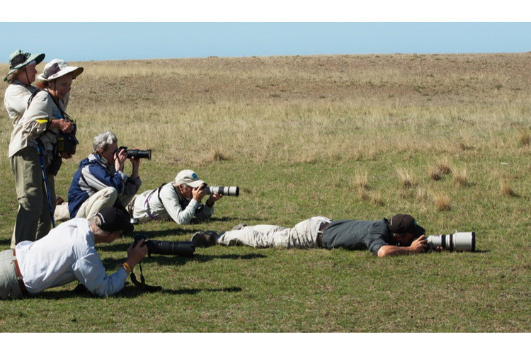 Patagonia adventure expedition slide showing travellers in Punta Delgada photographing a Mara
