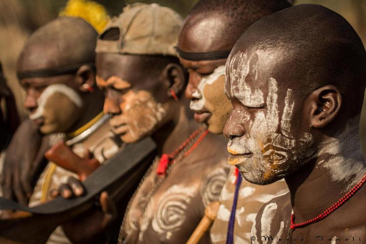 Ethiopia tours slide of Mursi men