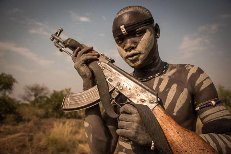 Ethiopia tour photo of Mursi man with gun