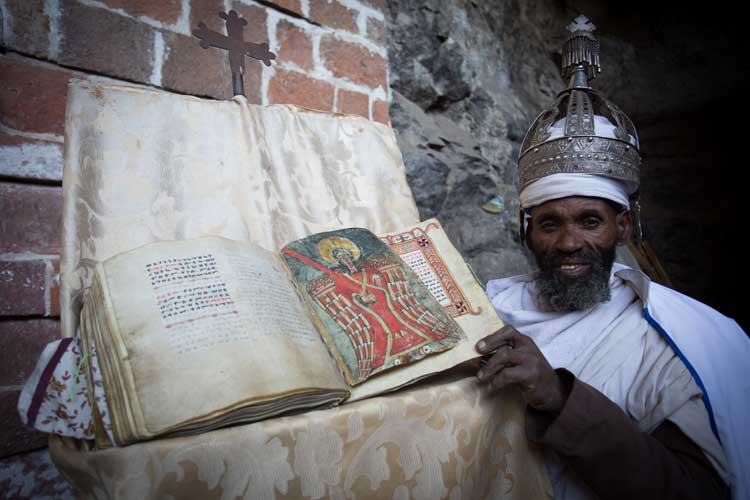 Ethiopia travel tour slide showing priest at church in Lalibela