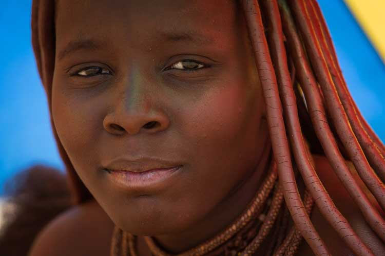Namibia expedition photo of Himba woman with mud-covered hair