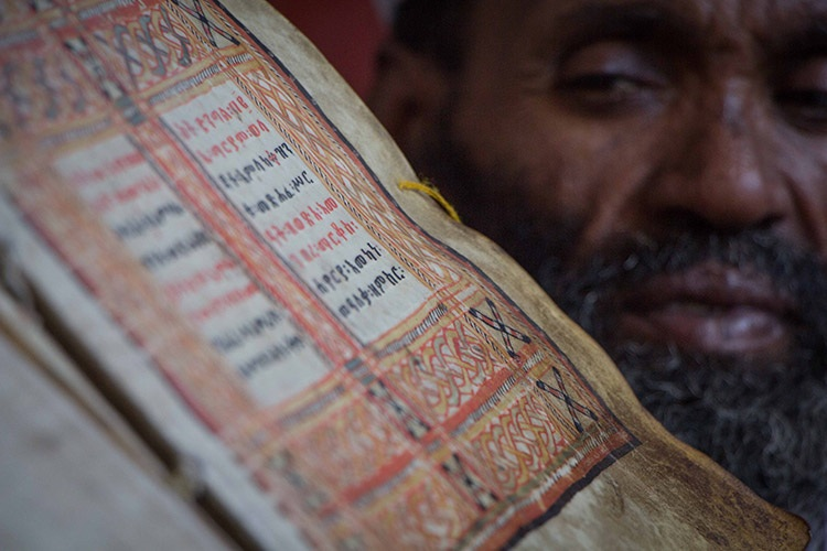 Ethiopian culture tour photo of lalibela priest holding scroll