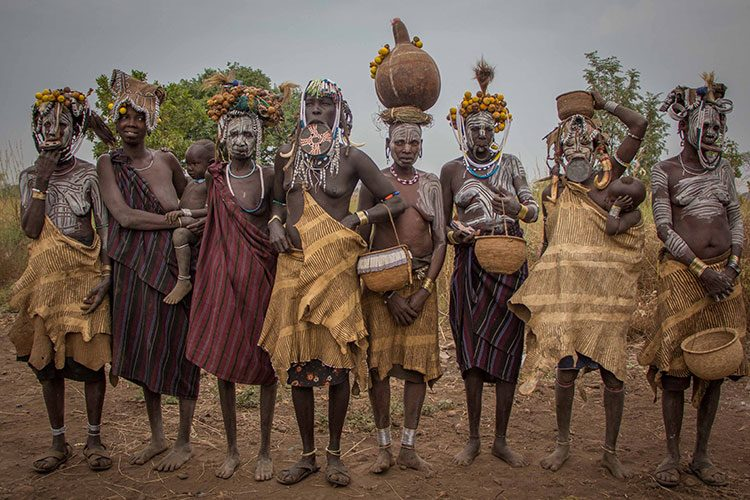Ethiopian travel tour photo of Mursi women holding baskets