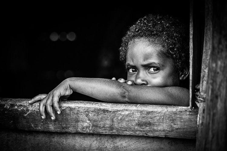 dani people photo of child staring at camera