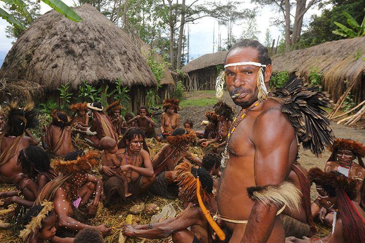 baliem valley resort photo of dani man in village with tribe