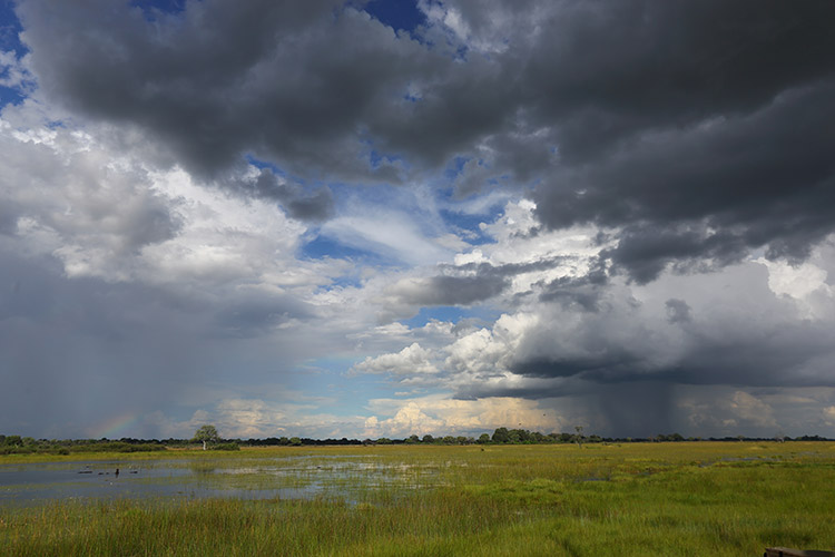 botswana adventure photo of stormy plains with rainbow