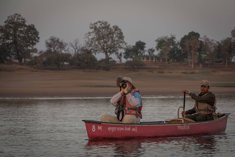 India wildlife safari traveler in boat on denwa river satpura