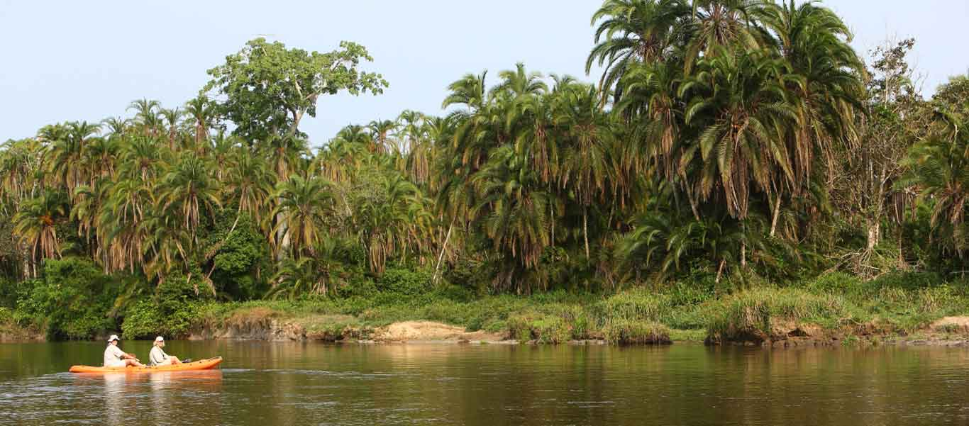 Congo gorilla trekking photo of kayaking Lekoli River