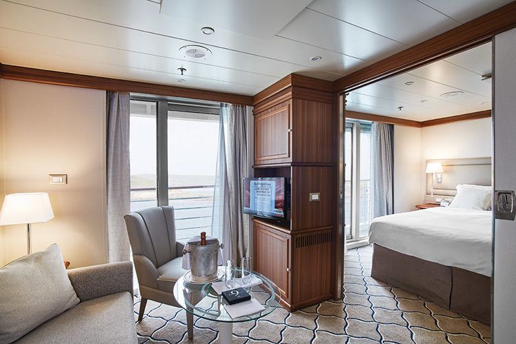Silver Explorer silver suite sitting area and bed