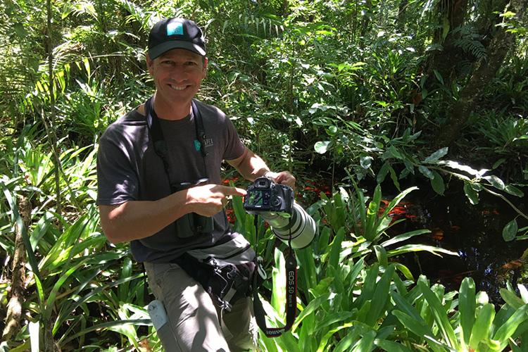 Jonathan with camera in Volta Velha Brazil on 9000 bird quest