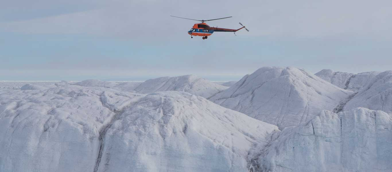 Travel to North Pole photo of helicopter over expanse of ice