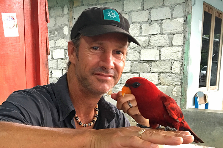 Image of Jonathan Rossouw with Red Lory on 9000 bird quest