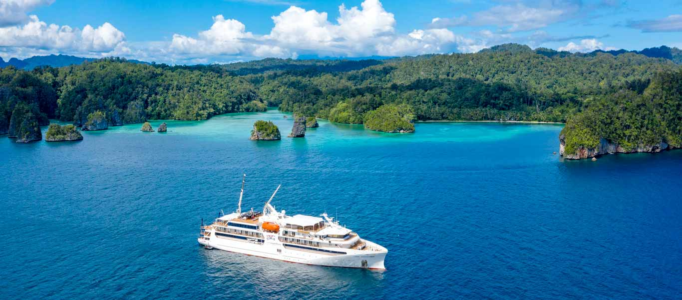 Raja Ampat cruise photo of Coral Adventurer among islands