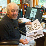 Photo of Peter Harrison with pages from seabird identification guide