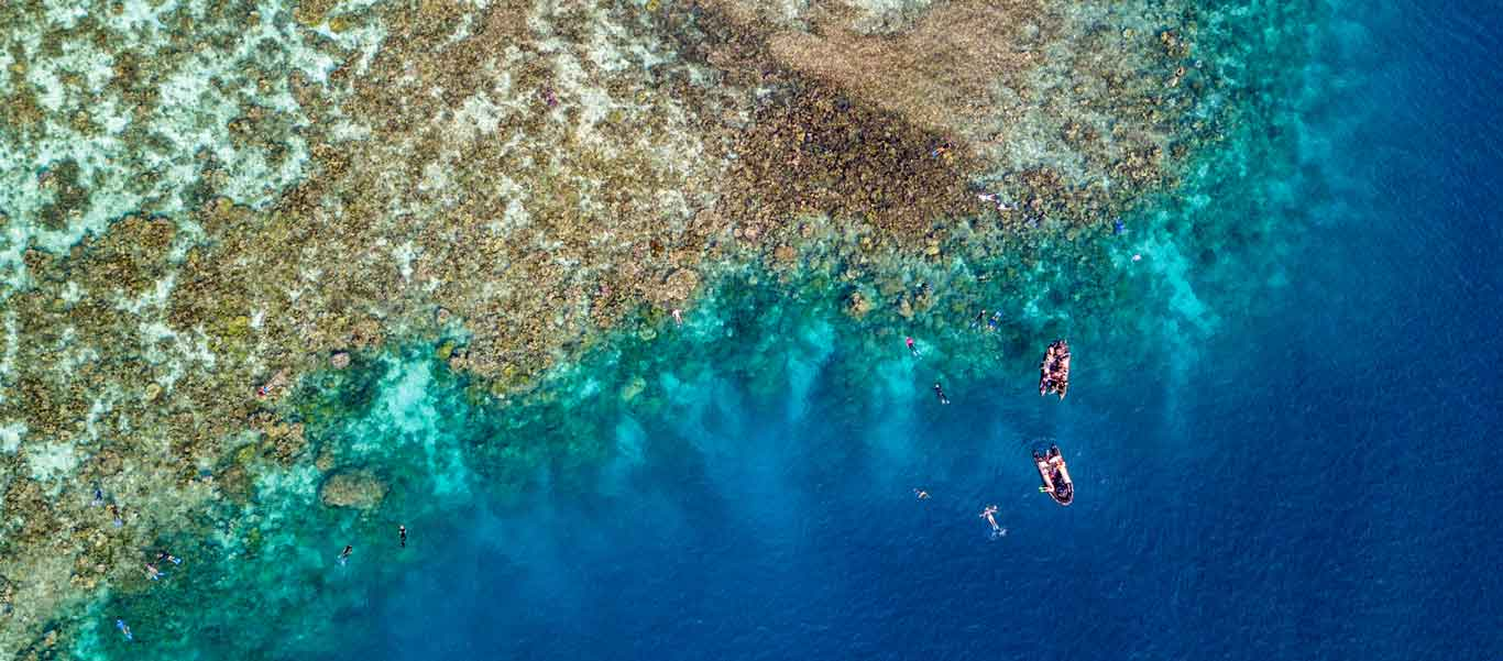 Micronesia & PNG Cruise aerial photograph of snorkelers at Dobu Island