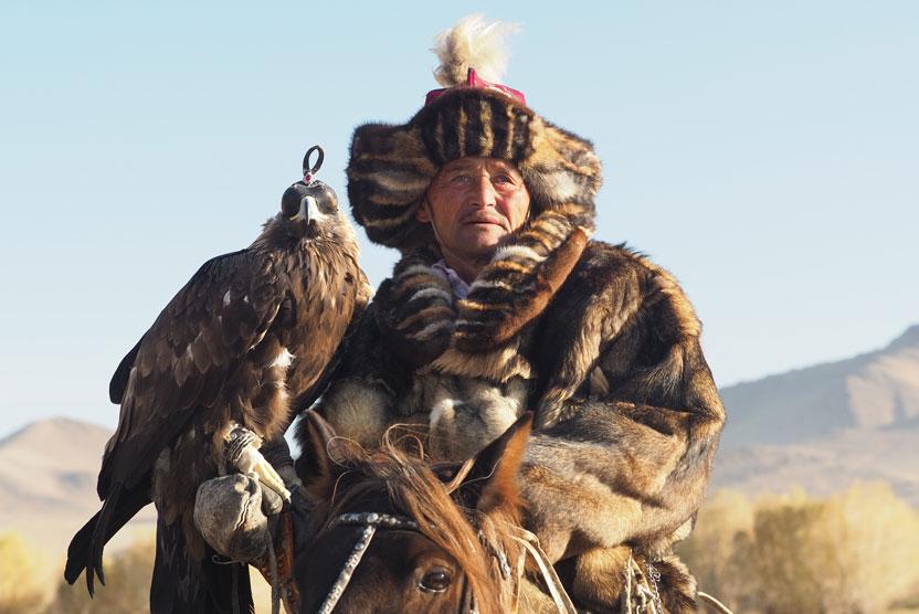 Golden eagle festival image of eagle hunter on horseback in Mongolia
